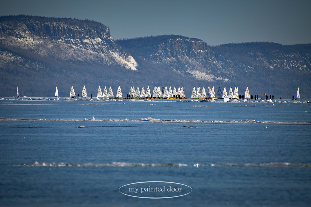 Ice boat racing on Lake Superior, Thunder Bay, Ontario. Photography by Sue Sikorski