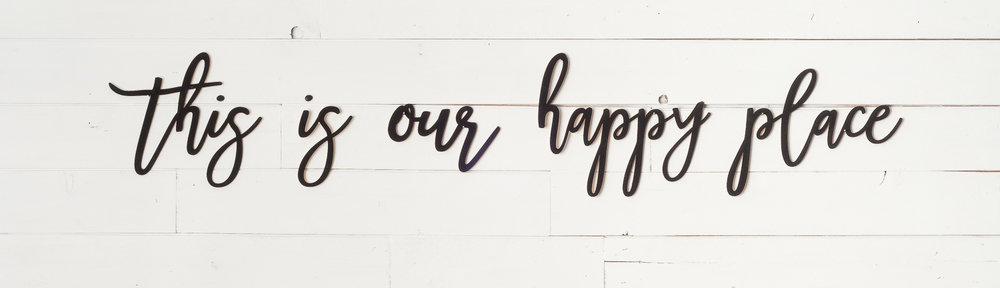 "Laser cut words ""this is our happy place"" available online at My Painted Door. Words painted in Coal Black Fusion Mineral Paint."
