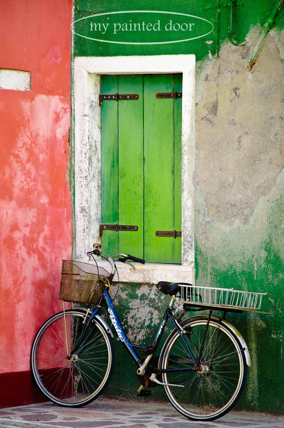 Bike leaning against a textured wall in Burano, Italy.