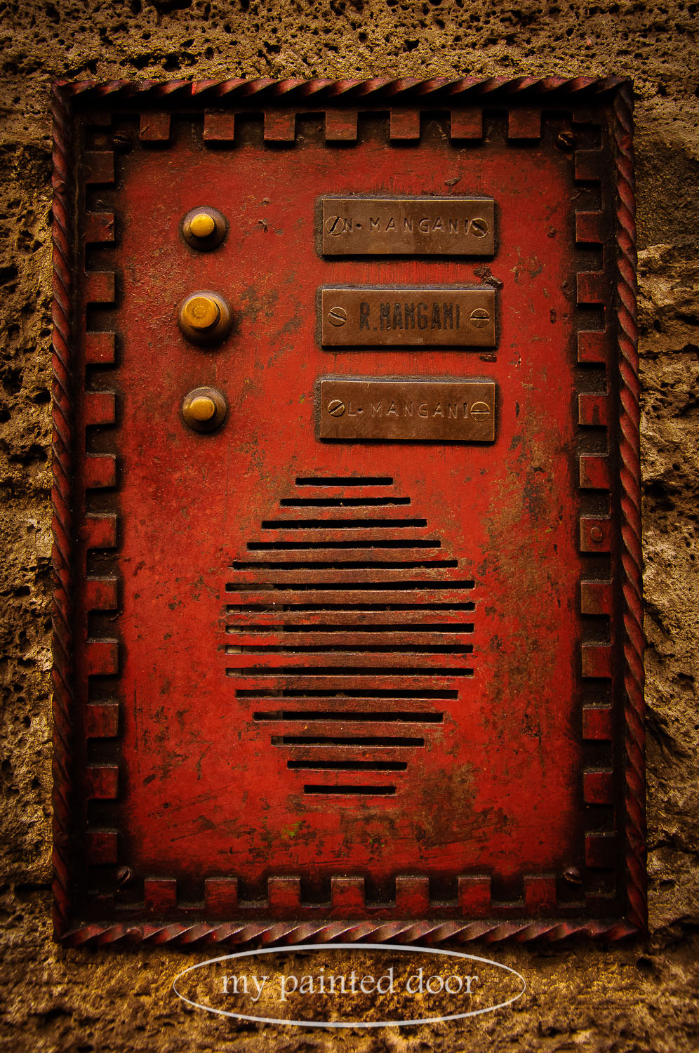 Bright red intercom system in Italy.