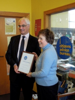 Volunteer Adviser, Kathleeen Haddow, receiving her 30 years Service Award from Rt Hon Alistair Darling MP