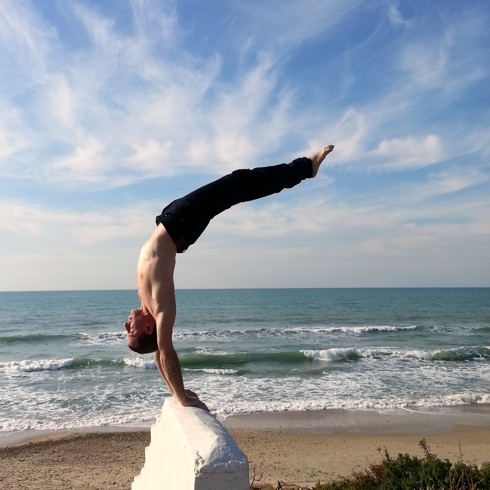 handstand on beach wall.jpg