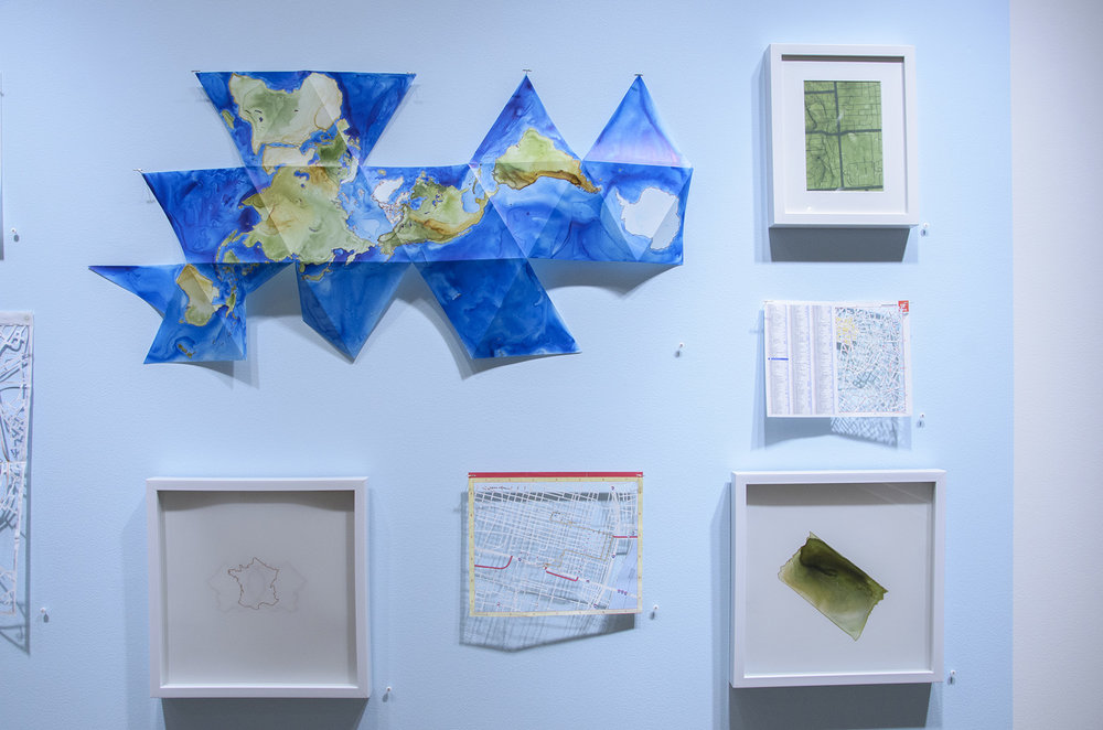Clockwise from top left: Buckminster Fuller Dymaxion Map, Memphis, Paris, Tennessee (distorted), St. Louis, France