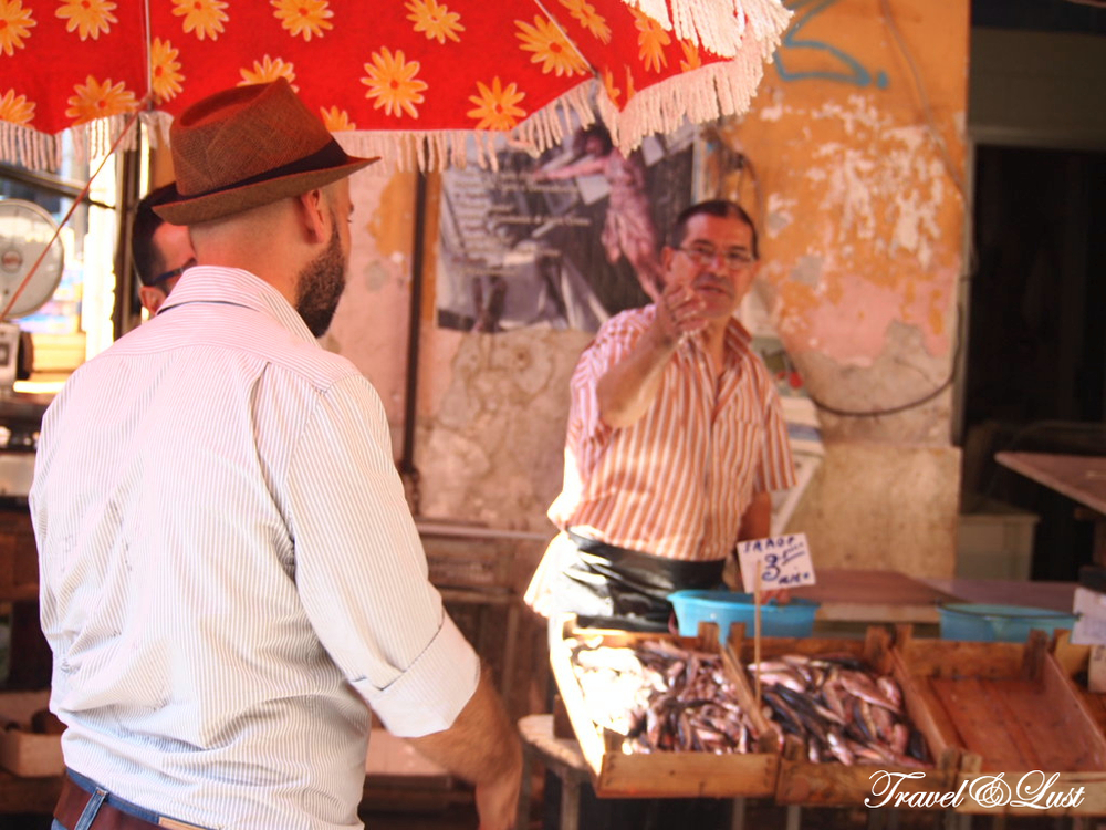 Don Saro knows the locals and can tell you the story of how their businesses came about. Here he is being entertained by a fish seller in the Ballaro market.