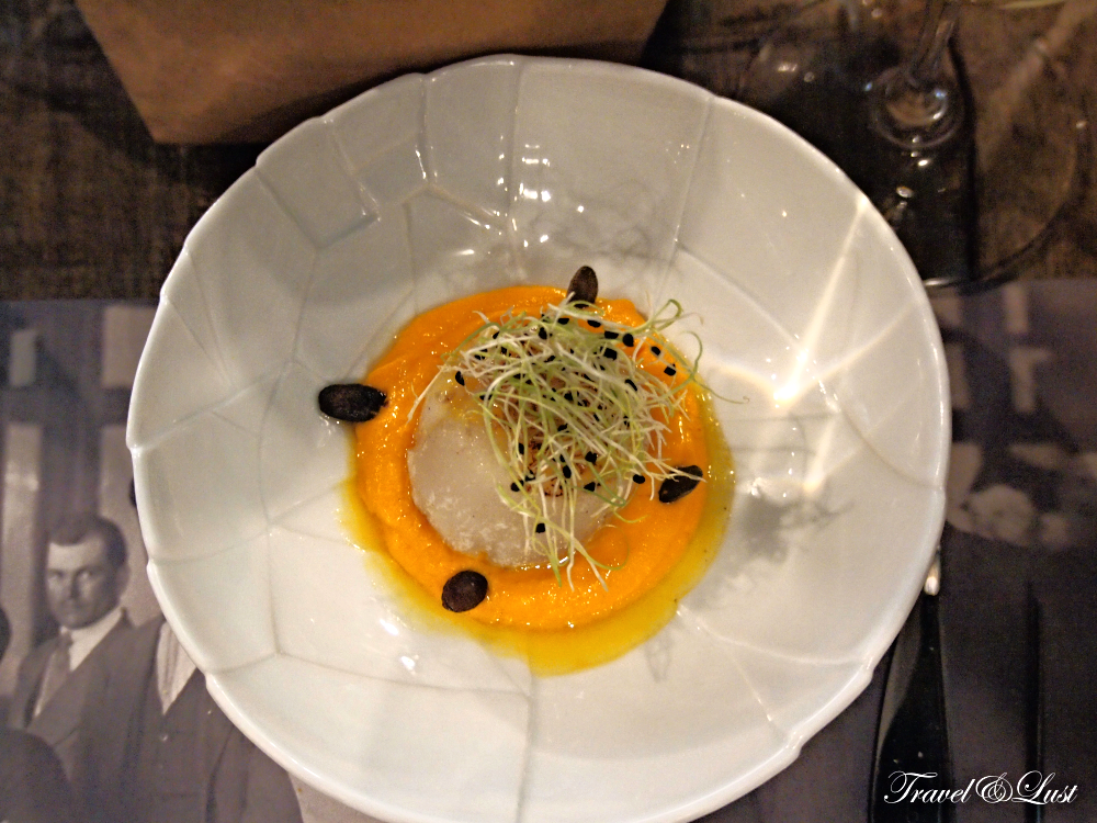 Sea scallop in orange sauce.