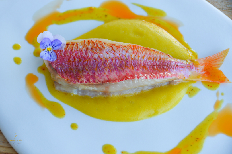 The fillet of Red Mullet, with yellow courgettes, chorizo and lemon, as prepared by French chef Arnaud Bignon.