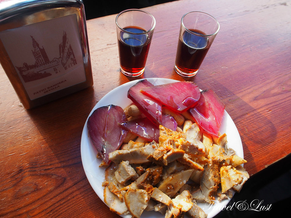 We tried mojama and chicharrones de Cádiz at the little Taberna Álvaro Peregil - La Goleta, this little bar can be found near the cathedral.  The word mojama comes from the Arabic musama (dry), but its origins are Phoenician, specifically from Gdr (Gadir, Cádiz today), the first Phoenician settlement in the Western Mediterranean Sea. The Phoenicians had learned to dry tuna in sea salt to prepare it for trade. Mojama is made using the loins of the tuna by curing them in salt for two days. The salt is then removed, the loins are washed and then laid out to dry in the sun and the breeze (according to the traditional method) for fifteen to twenty days. The chicharrones de Cádiz are belly of pork, served with lemon juice and cumin, typical in the province of Cádiz, only 1 hour drive from Seville.