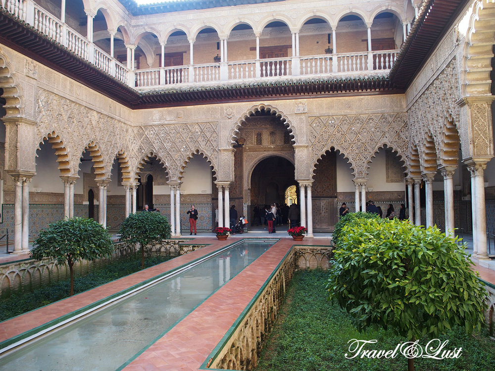 The second most visited place for tourists in Seville is the Alcázar.In 913 the Umayyad Caliph Abderramán III ordered a new centre of government built in Seville on the site of an old Visigothic settlement that had previously been Roman. This multicultural curiosity about its foundation seems a foretaste of the many historical ups and downs that would shape its current appearance. After the disintegration of the Caliphate of Cordoba, the Royal Alcazar would pass into the hands of the Abbesses (Taifa of Seville), the Almoravid emirs and, in the last Islamic stage, the Almohads. The successive reforms of that time had already made the Reales Alcázares a large palace complex surrounded by walls in the middle of the XIII century.