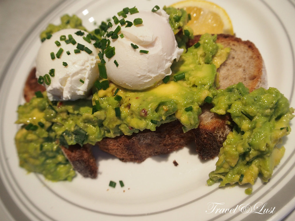 A great vegetarian offering for brunch; eggs, avocado, chilli, and lemon on toast.