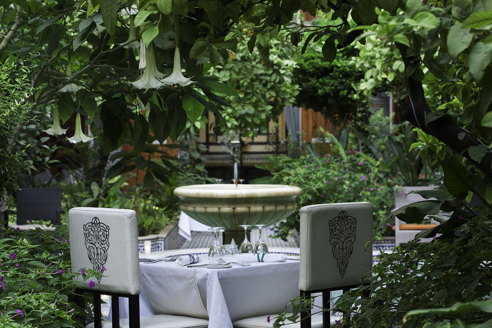 The stylish inner patio, a perfect spot for intimate dining.