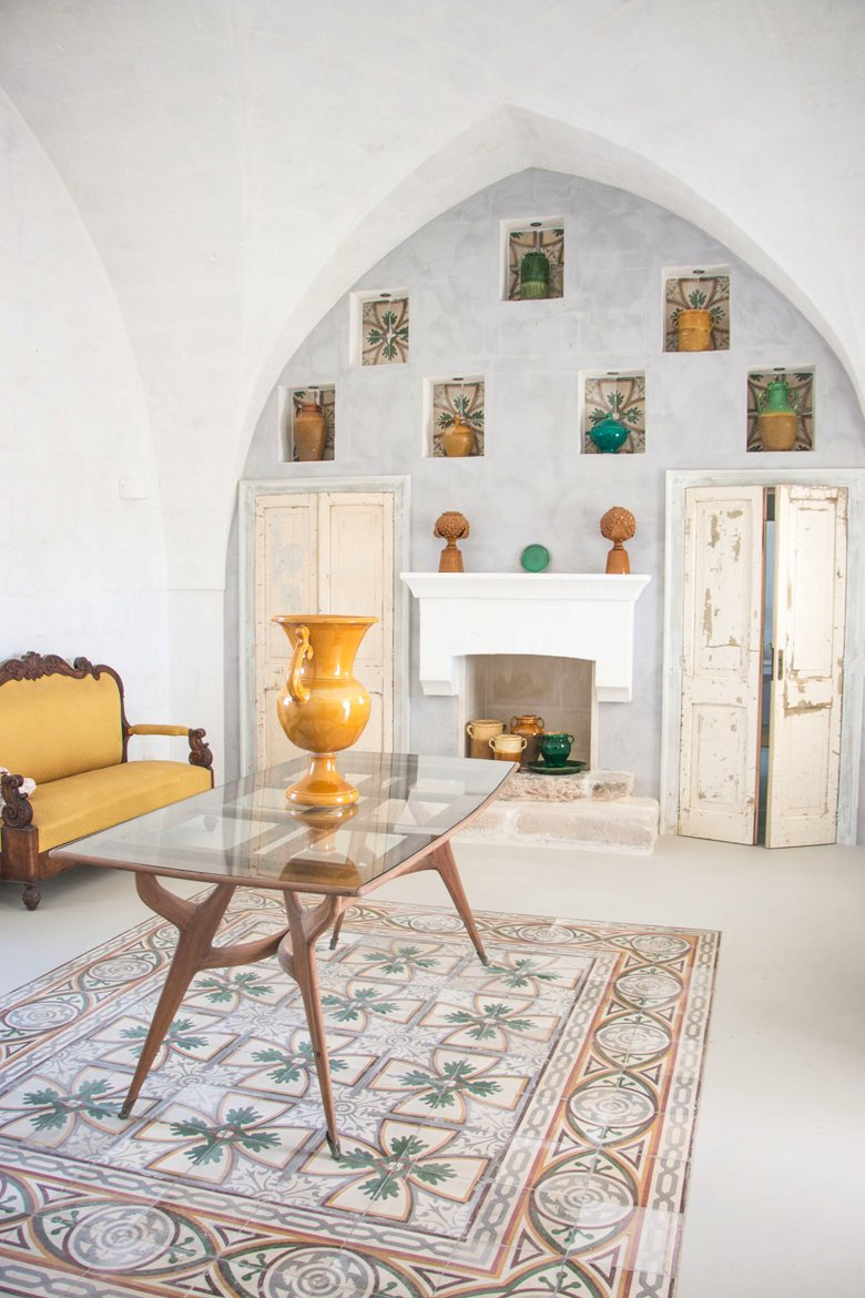 All of the natural light you need, tiled flooring, distressed wooden doors and vintage furniture.Image © Masseria Potenti.
