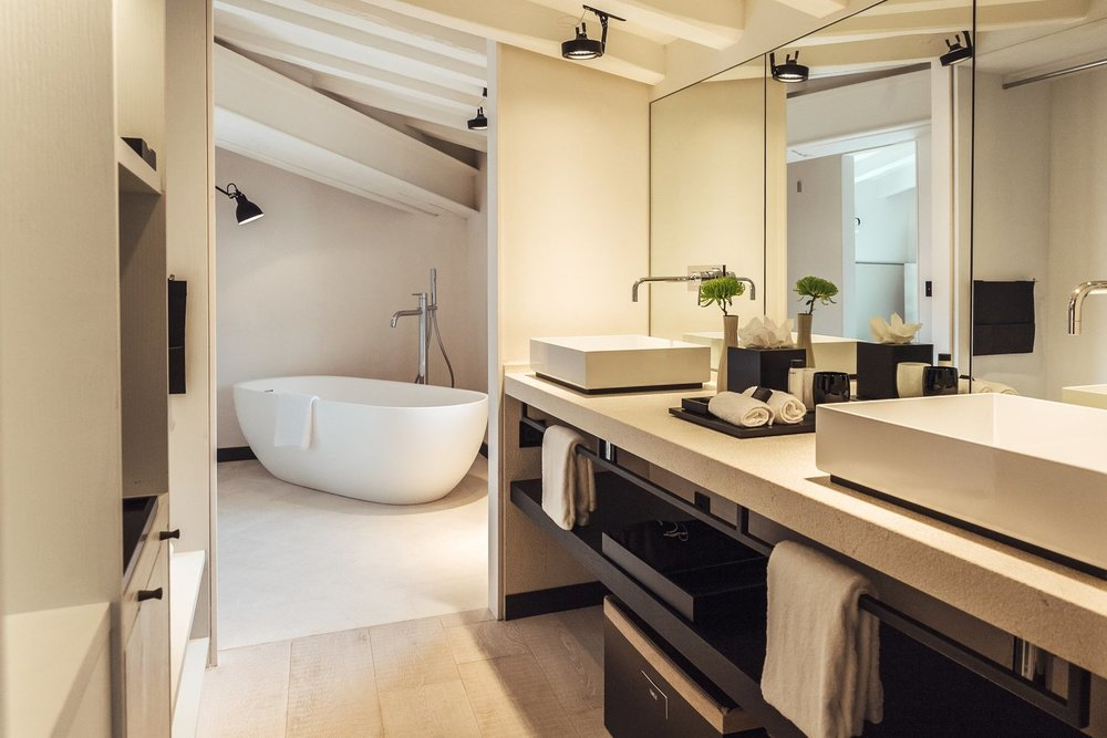 The bathrooms all have a deluxe walk-in rain shower and some suites combine with a bath tub.