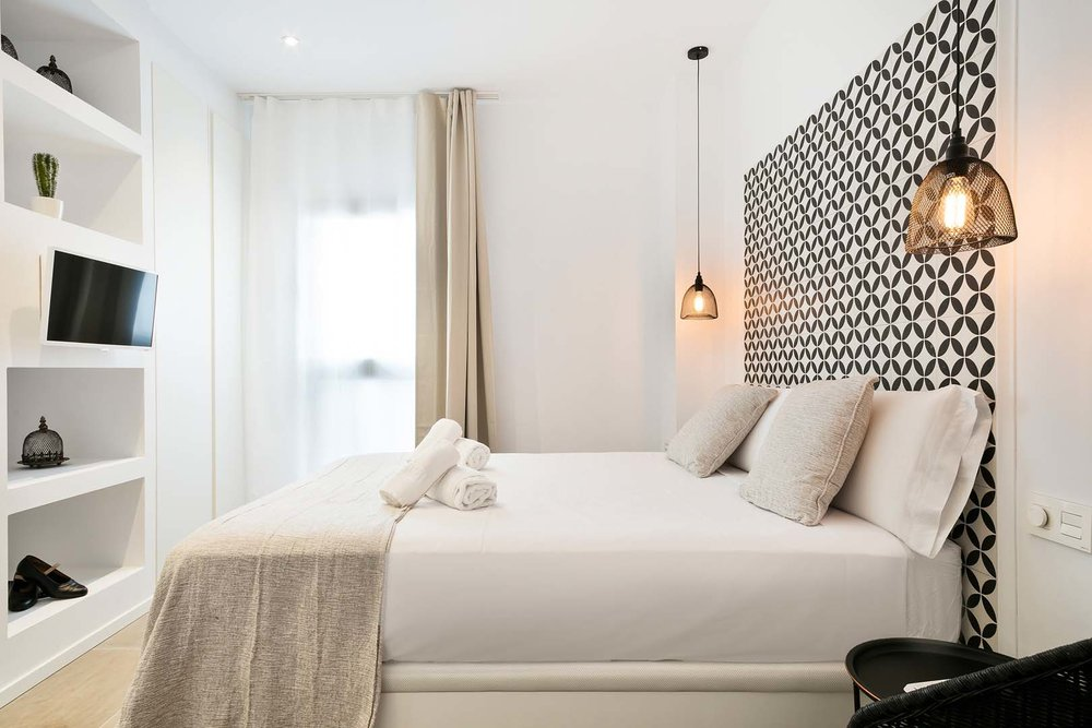 Boutique bedrooms, simple with beautiful sourced items.