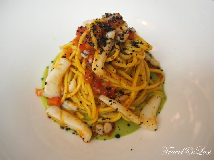 Handmade spaghetti, cuttlefish, zucchini cream, mint and black breading.