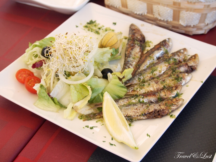 Sardines drizzled with basil-infused oil, parsley and garlic.