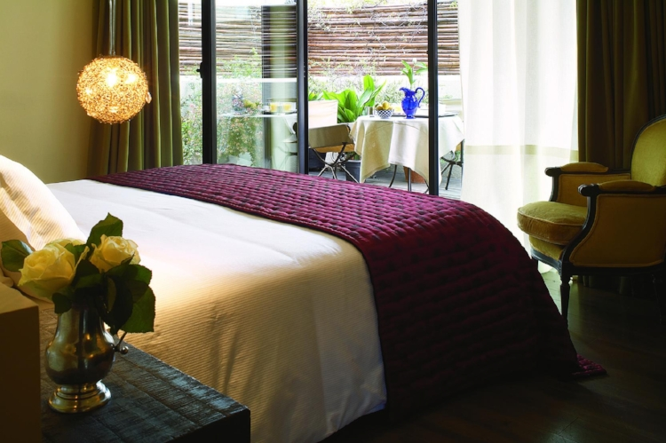 Deluxe room at Hotel Neri, Barcelona, located in a quaint square in the Gothic quarter.