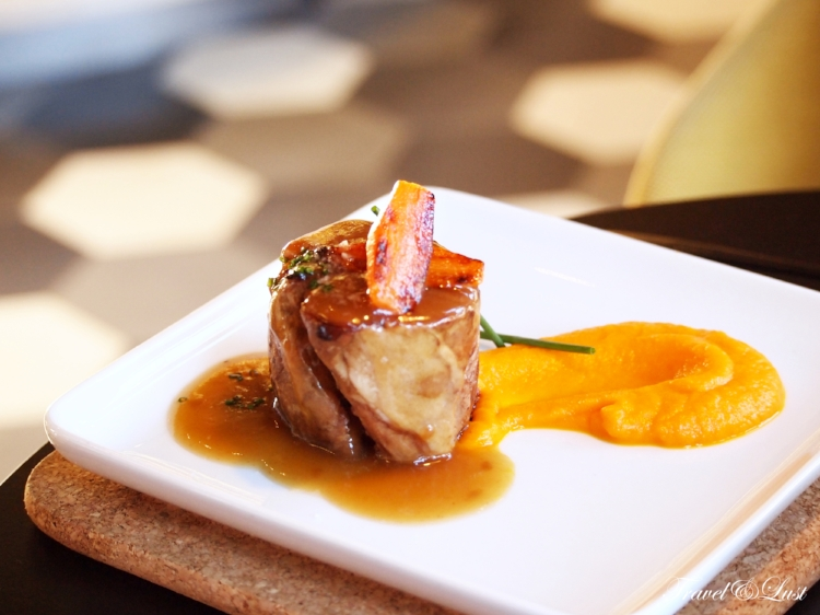 Medallion of confit lamb with carrot puree and anise.