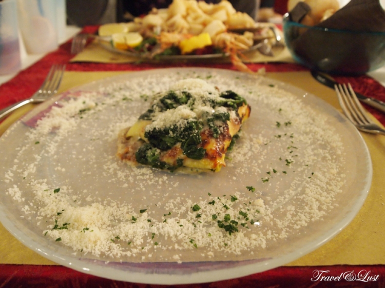 Spinach cannelloni with the Grand B fish plate (selfishly blurring) in the background.