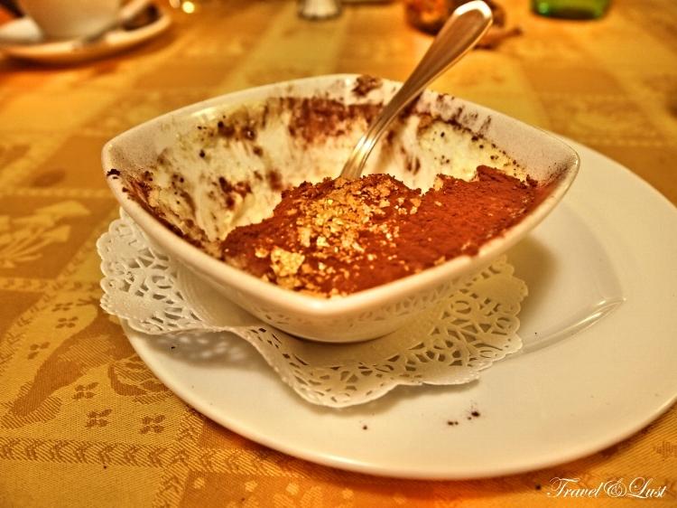 Tiramisu with a sprinkle of gold at Restaurant Taverna dei Golosi.