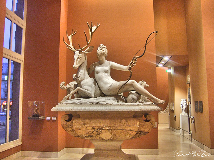Diana and the Stag Goddess of hunt Artemis. A figurine sculpture of the Greeks.