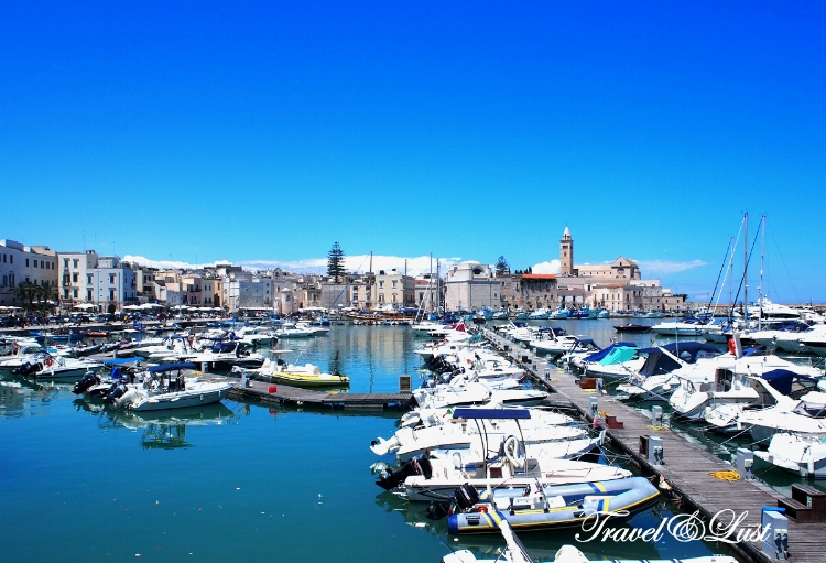 The Trani harbour with Trani Cathedral in the background.