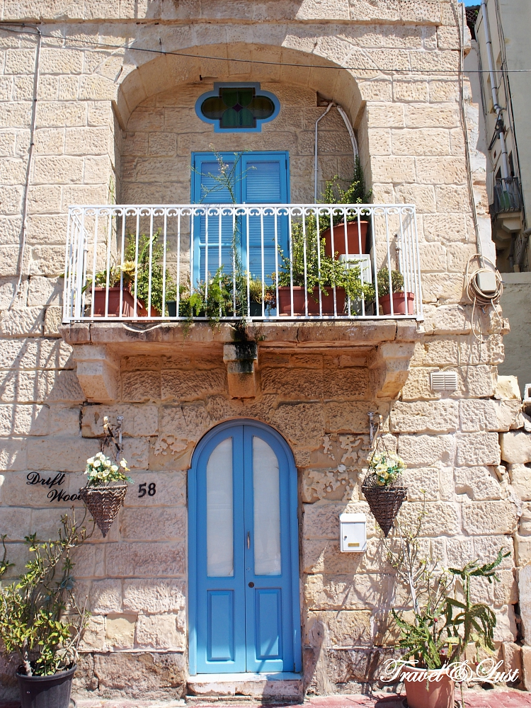 Cute door and windows in the south-eastern village of Kalkara.