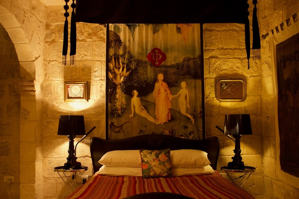 The exquisite bedroom with Art Nouveau bed and antique tapestries