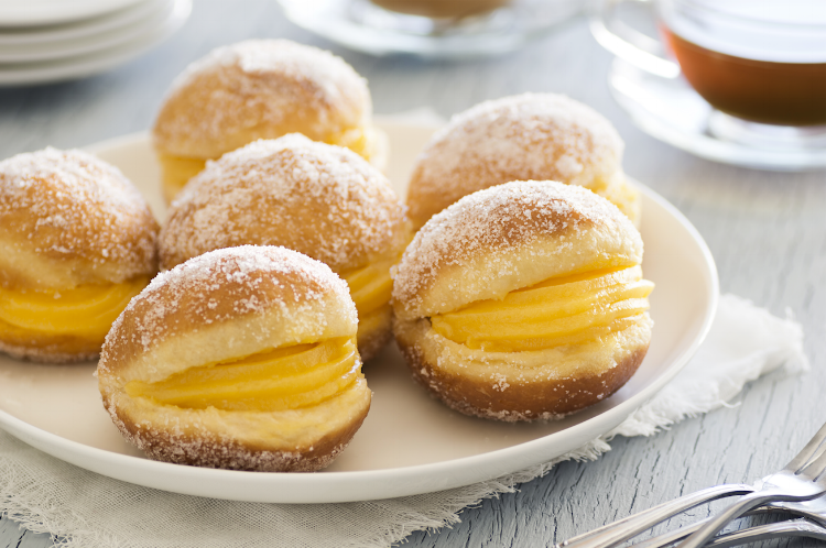 "Bolo de Berlim, or ""Berlin Balls"": Portuguese Fried Dough Rolled in Sugar and Filled With Ovos Moles"