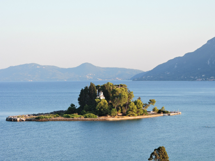 Pontikonisi Island is just near Corfu old town. This petite island houses the Byzantine church of Pantokrator, standing high above the rest of the landscape.