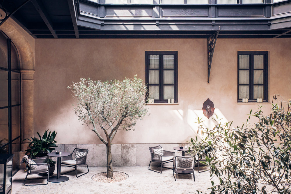 The hotel patio bathed in natural light, making it an ideal nook for relaxing.