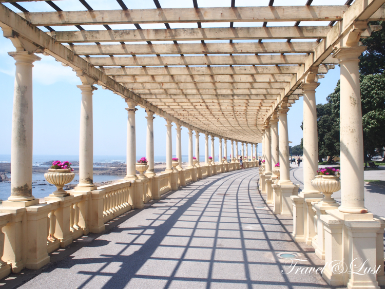 The beautiful Atlantic oceanfront promenade with the pergola walkway standing on pillars in Foz do Douro neighbourhood is a must walk through.