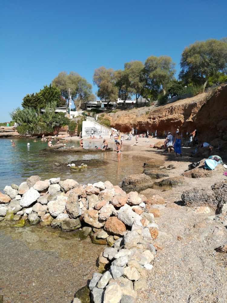 Swim with the locals at Vouliagmeni's small beach coves.