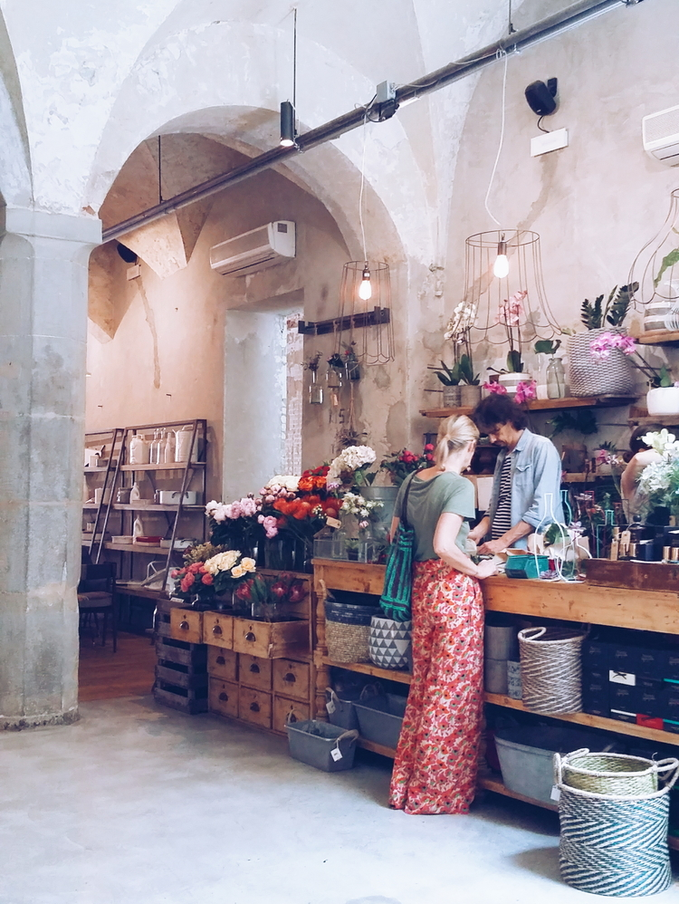The flower store Artemisia Fioristi located inside the restaurant of colourful and artsy concept store La Ménagère.
