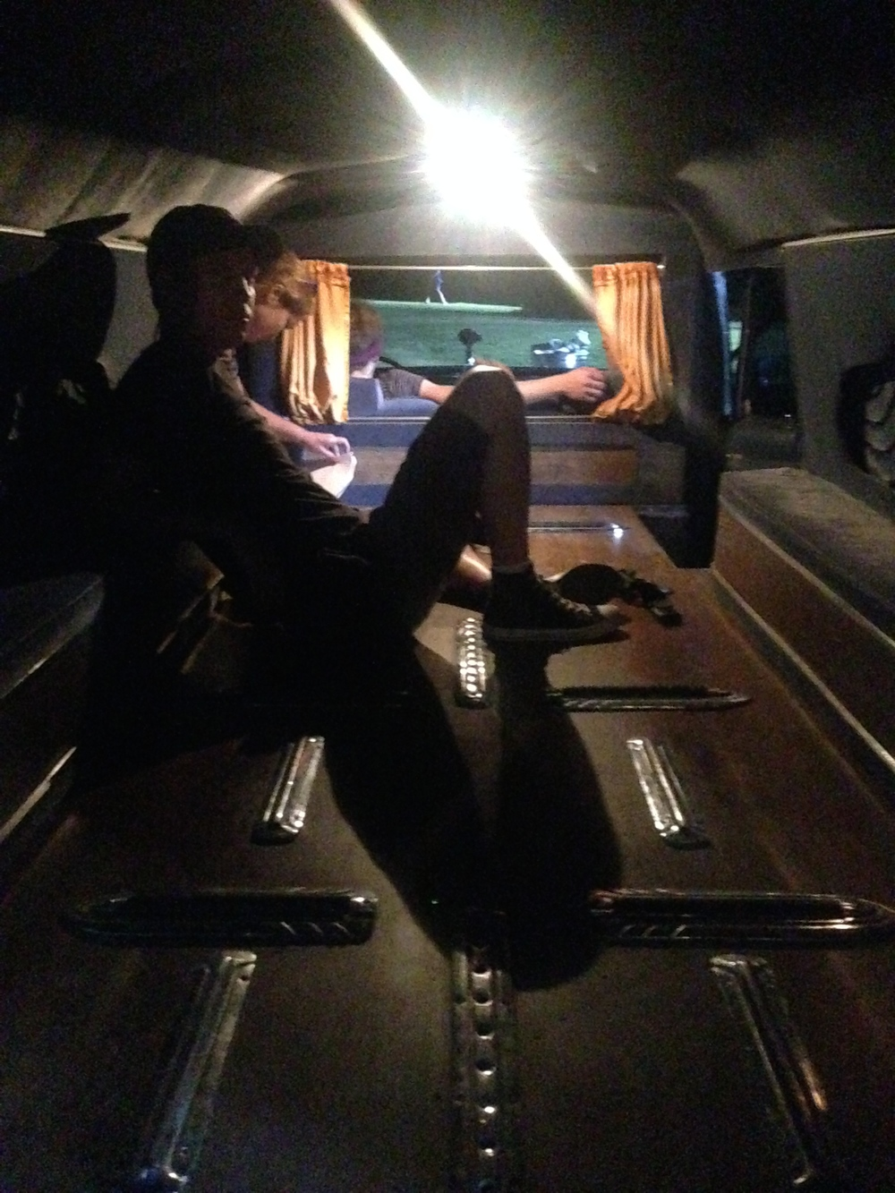 Oren gets comfortable in the hearse.