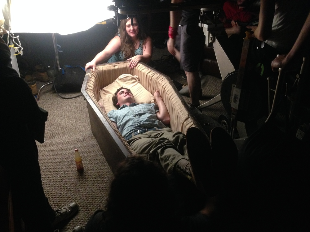 Ian kicks back in the coffin.