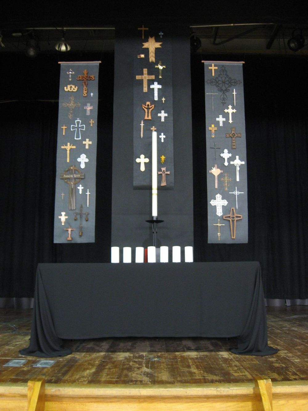 Good Friday focal point, with community devotional crosses on gray window screening