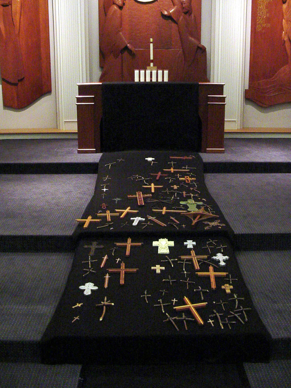Good Friday Chancel Installation with frontal extended into vertical runner, with community crosses placed during worship