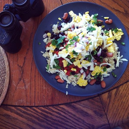 Mexican burrito bowl lunch -- rice, beans, shredded jicama, corn, salsa, cilantro and lime juice.