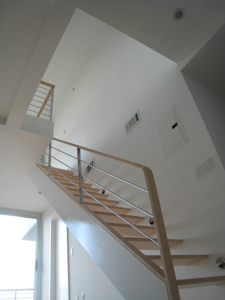Stairs, railing and a second floor in an apt 18' ceilings. My last finished renovation in Brooklyn. August 2008