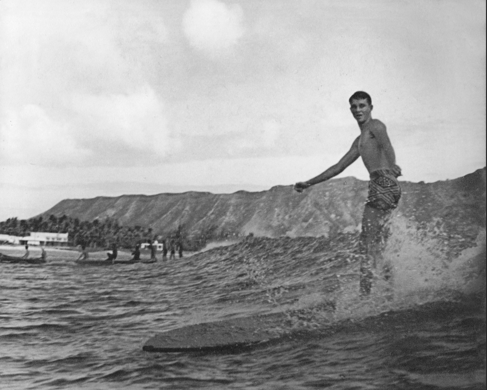 Start with a favorite family photograph. Here is one with our client's dad surfing in the 50's . . . .