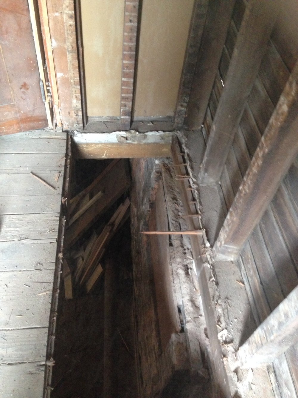 subfloor and framing needed to be replaced. This was an old staircase to the basement.