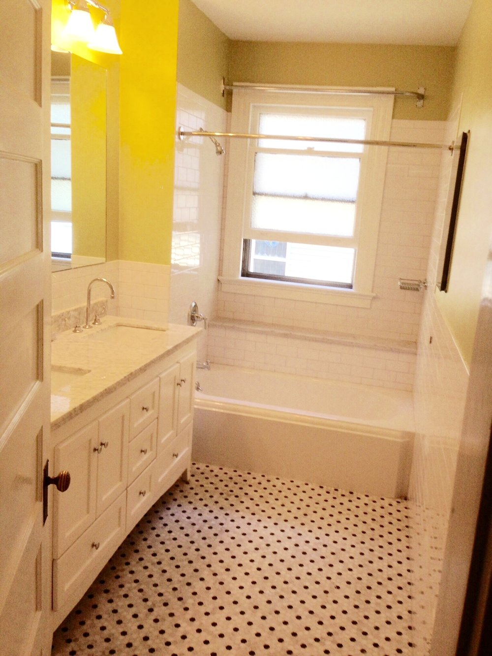 Marble hex floor, kohler memoirs tub, subway tile.windows can be a problem. so we built in a shelf, and put in a curtain