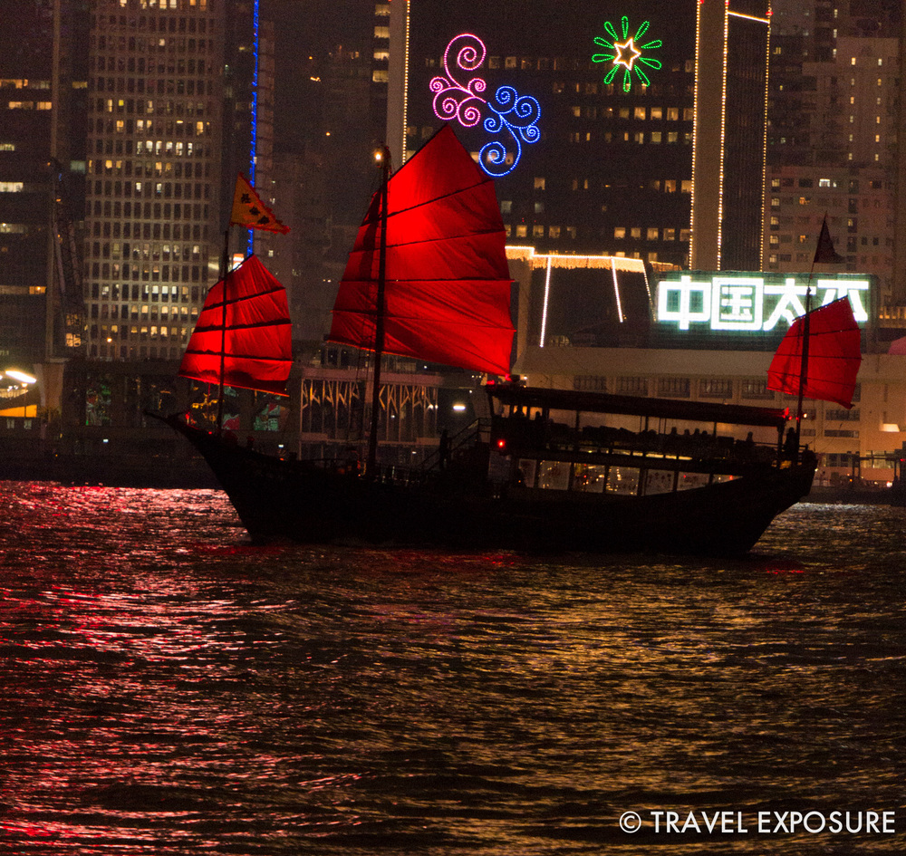 """One of the """"junk boats"""" sailing in Victoria Harbor, just before we saw the nightly """"Symphony of Lights"""" show."""