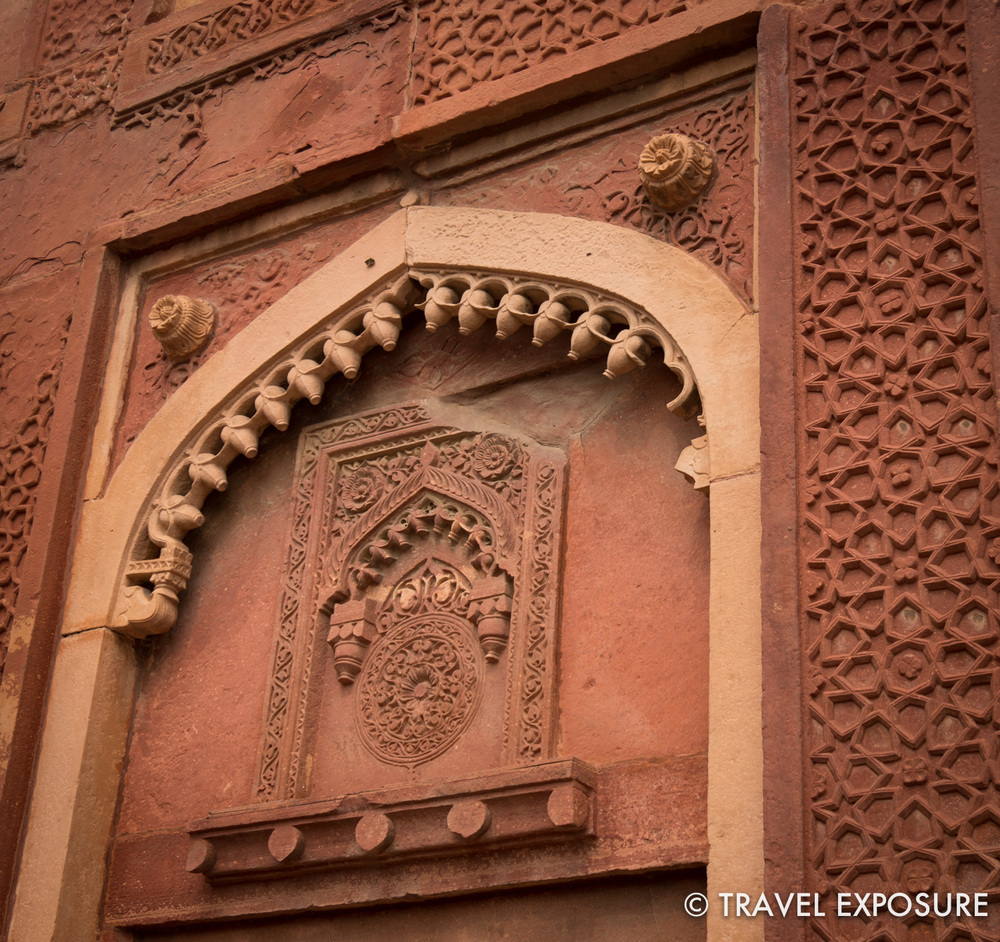 At Agra Red Fort: Delicate Hindu ornamental design is blended with Islamic stars and arches.