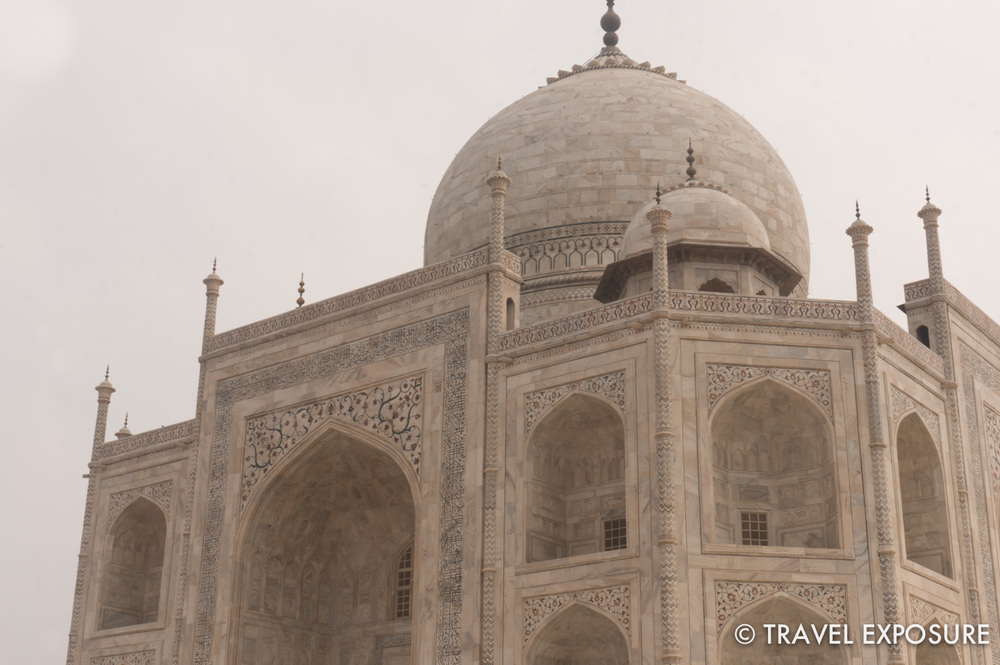 The dome of Taj Mahal resembles an upside-down closed lotus resting on its petals.