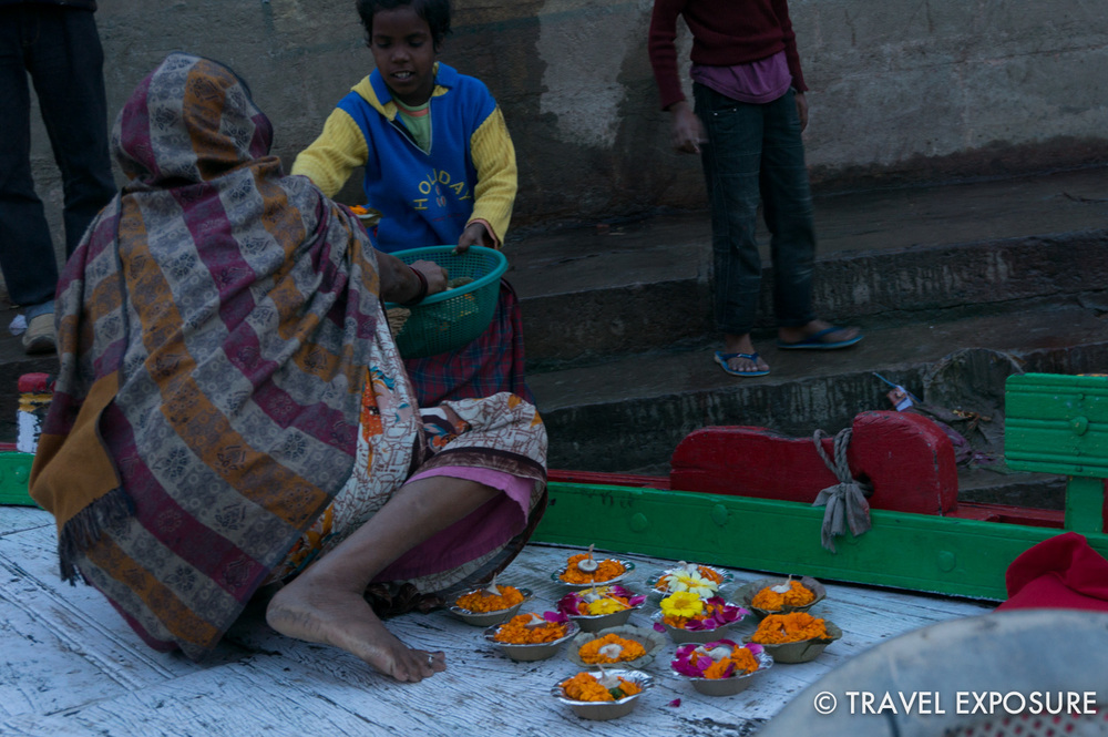 A woman selling candle offerings in Varanasi