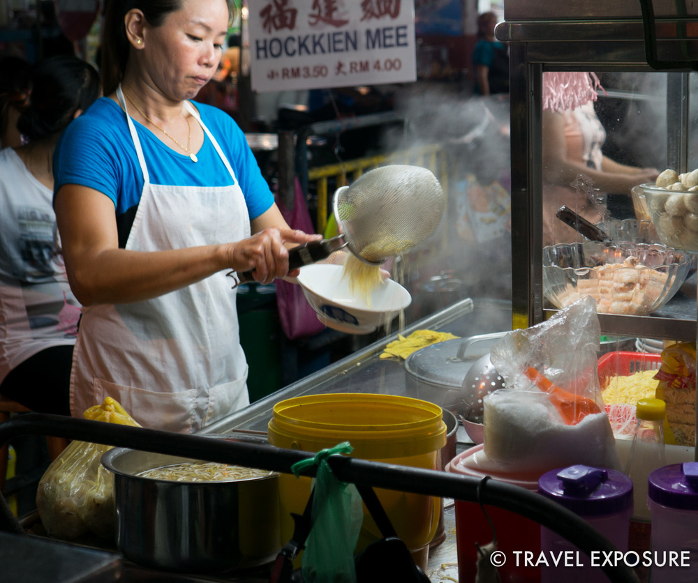 WEEK OF SEPTEMBER 15 A woman prepares noodles to make Curry Mee at a hawker stall in Penang, Malaysia.
