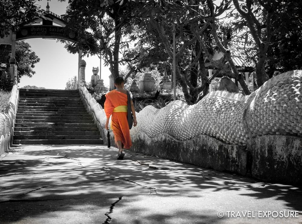 WEEK OF SEPTEMBER 29 A young Buddhist monk walks up to the Wat Hosian Voravihane in Luang Prabang, Laos.