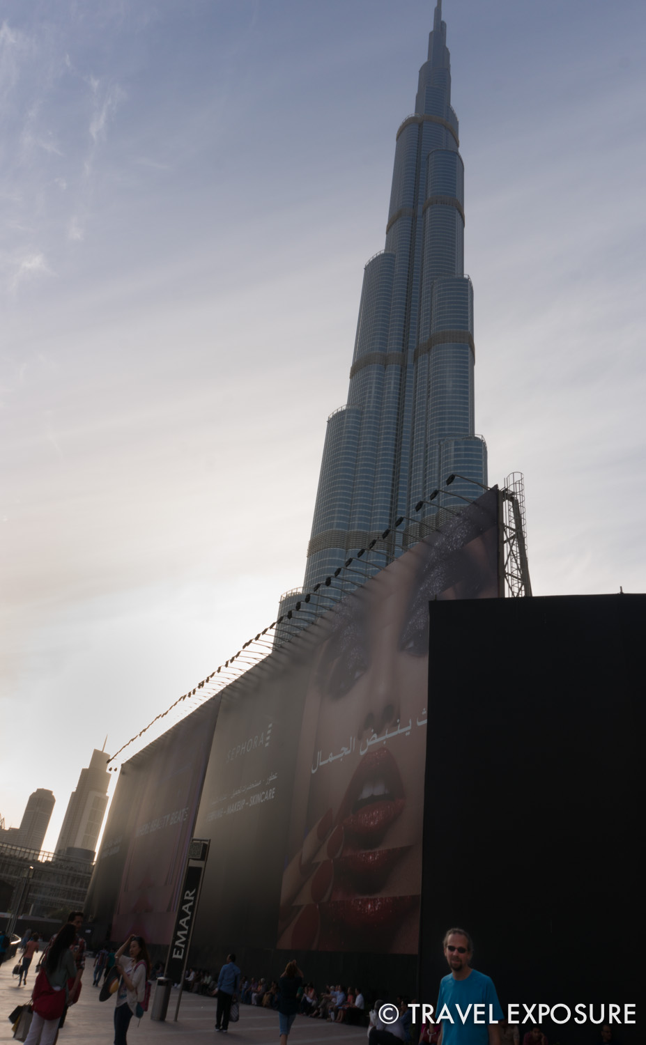 Root stands by the Burj Khalifa, the tallest building in the world, in Dubai.