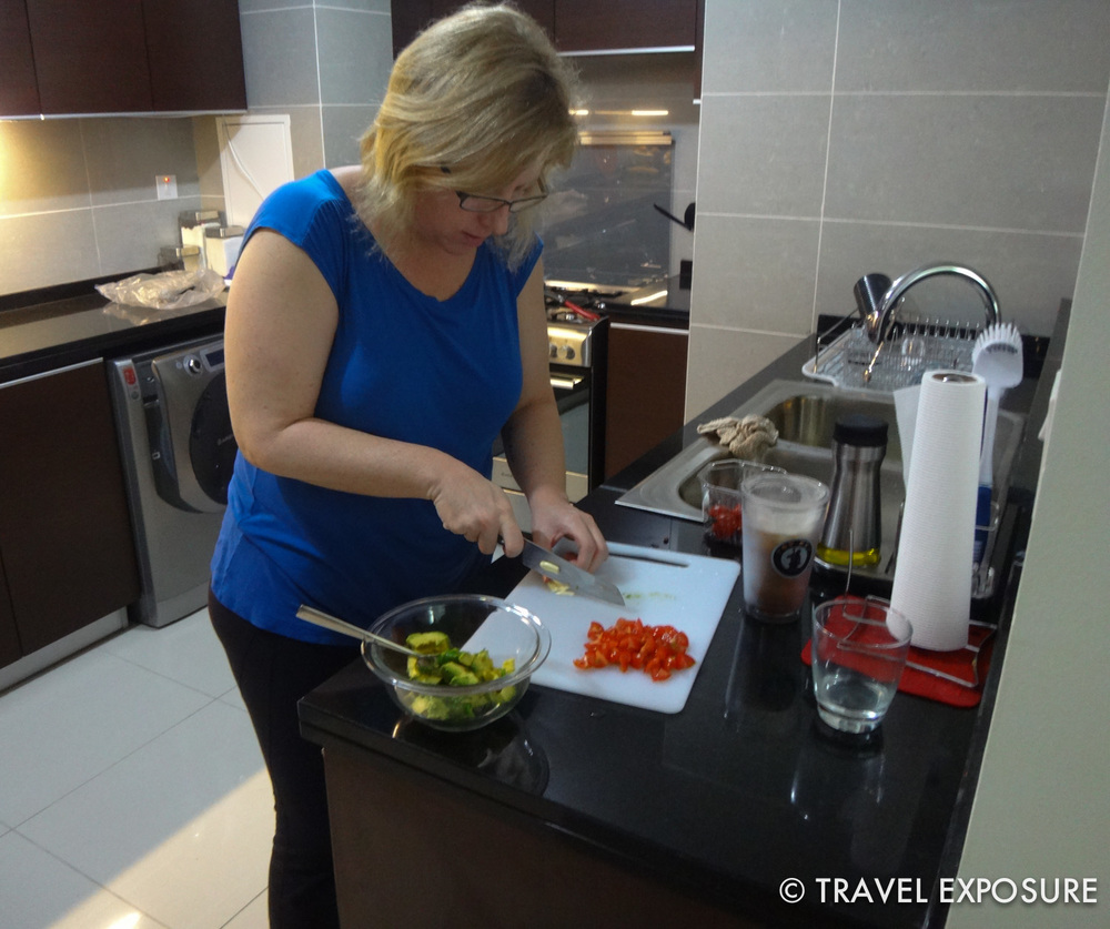 In Kathy and Brian's new apartment in Abu Dhabi - making a Mexican omelet for breakfast.